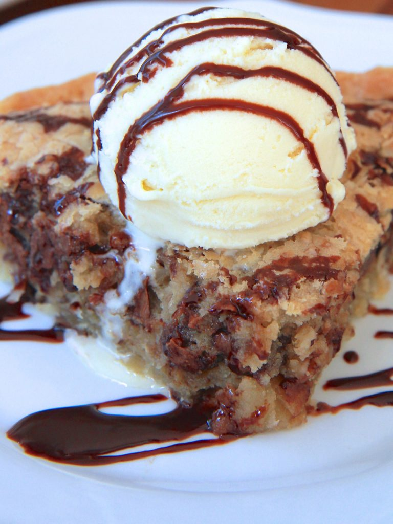 Hot, gooey chocolate chip cookie pie with a buttery pie crust ...