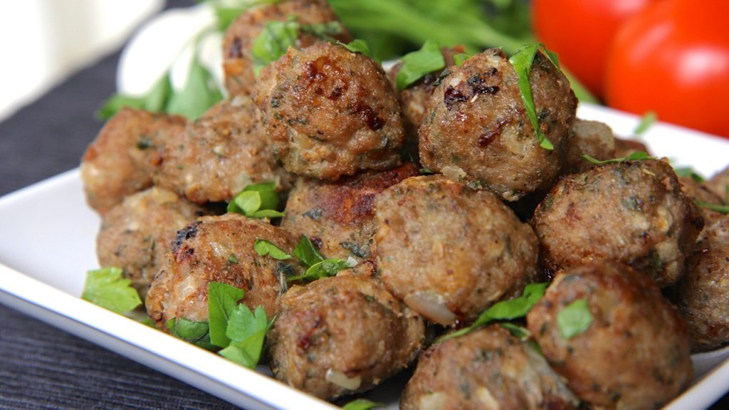 Simmering meatballs in a sauce is an effective way to reheat without drying them out. Place meatballs in a pot of sauce, cover and simmer over low temperature on the stove for 20 to 30 minutes. Do not let the sauce come to a boil.